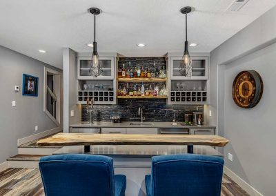 Beaverton Basement Bar with High-Top Chairs and Wooden Bar Counter
