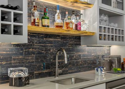 Bar Shelf with Spirits above Sink in Basement Addition