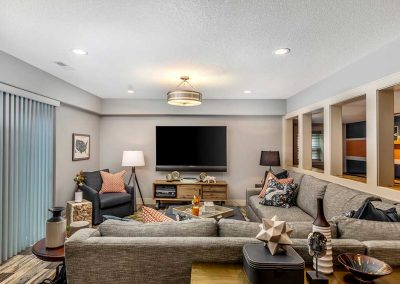 Furnished Family Room Remodel with L Shaped Couch