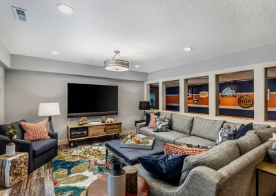 Basement Game Room Remodel with Gray Navy and Orange Decor