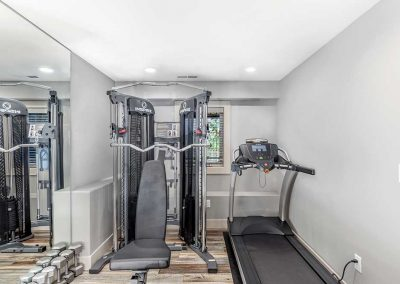 Basement Home Gym with Treadmill and Weights