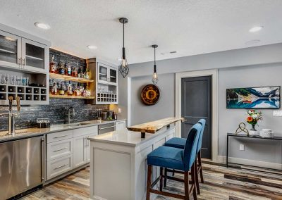 Beaverton Basement Bar with Gray Interior and Multi-Colored Wood Floors
