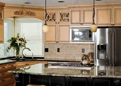 Vintage Kitchen Decor with Carved Wood Cabinets and Sleek Marble Island