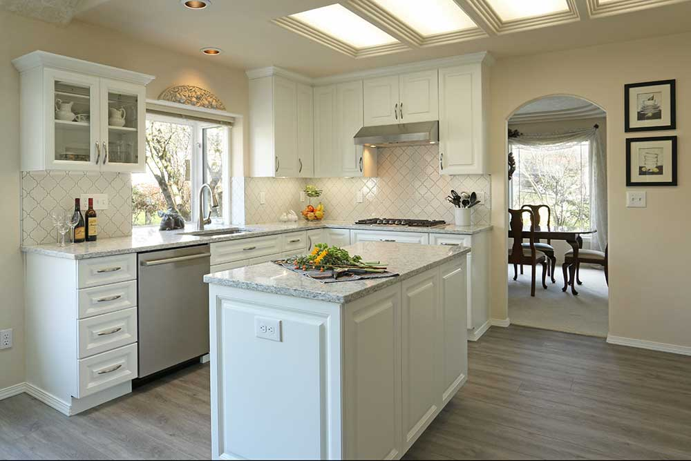 Traditional Kitchen with White and Egg Shell Colored Cabinets and Marble Island Counter in Gresham