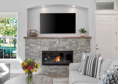 Contemporary Stone Fireplace in Living Remodel Project