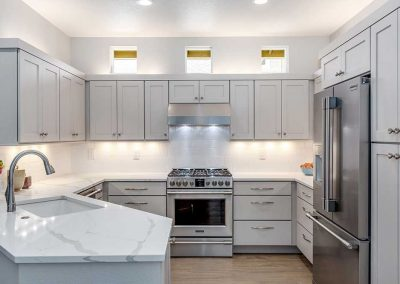 Hillsboro Open Kitchen with Simple Color Scheme and White Counter