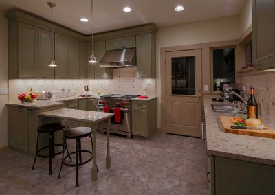 NW Portland Universal Design Kitchen with Olive Cabinets Marble Counter and Stools
