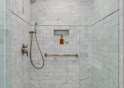Full Carrara Marble Shower with Gold Fixtures in Portland Master Bath Remodel