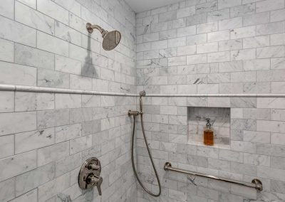 Carrara Marble in Master Bathroom Shower with Nook and Bronze Features