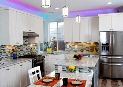 Portland Hi Tech Kitchen with Colored Lighting Above Cabinets