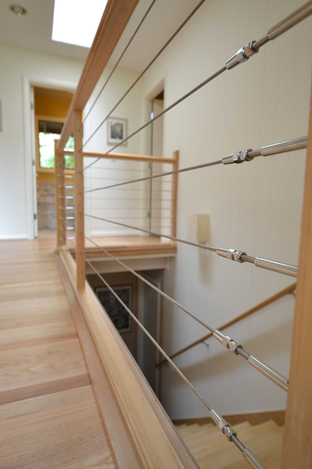 Remodel Staircase with Wooden Floors and Cable Railing