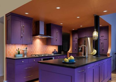 Colorful Kitchen with Purple Cabinets and Black Granite Countertop