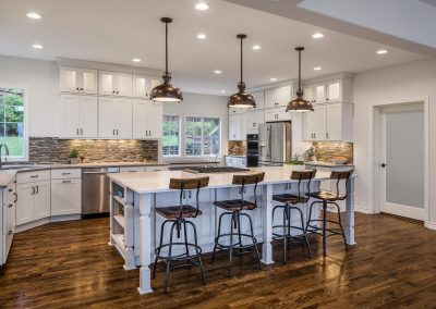 Open Concept Kitchen Remodel with Hardwood Floors and Bright Lighting