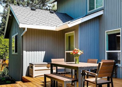 Backyard Deck Expansion with Outdoor Table in Lake Oswego Home Remodel