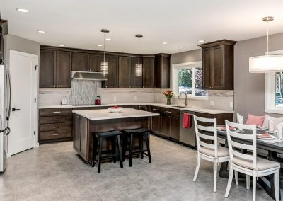 Open Transitional Kitchen and Dining Area with Brown and White Decor in Lake Oswego