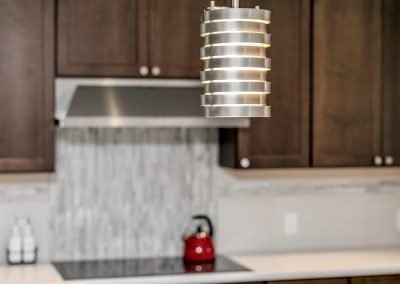 Kitchen Light Fixture Above Island Countertop and Bowl of Apples