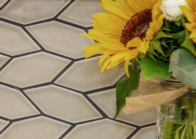 Portland Clayhaus Crystal Hex Backsplash with Sunflowers