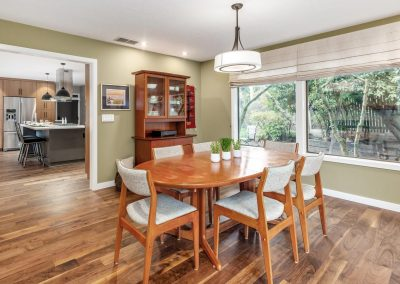 Mid-Century Open-Spaced Dining Room with Wood Floors