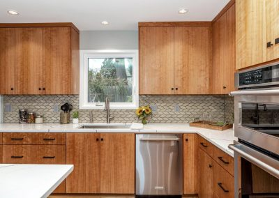 Mid-Century Modern Kitchen with Leaf Tile and Wooden Cabinets