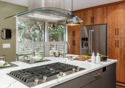 Mid-Century Kitchen with Island Stove and Marble White Countertops with Wood Cabinets