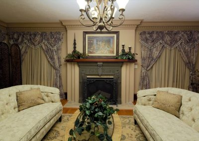 Historical Living Room Restoration with Two Couches Fireplace and Royal Drapes